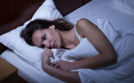 woman suffering from vaginismus lying in her bed
